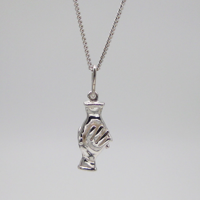Helping Hand necklace in sterling silver handmade by Joanna Lovett Sterling shows two hands clasped